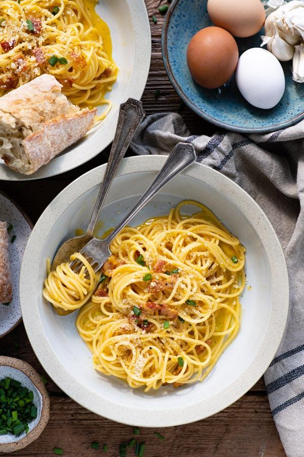 Overhead shot of a bowl of simple spaghetti carbonara