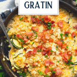 Overhead shot of zucchini au gratin with text title overlay