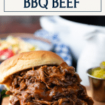Side shot of shredded bbq beef sandwich with text title box at top