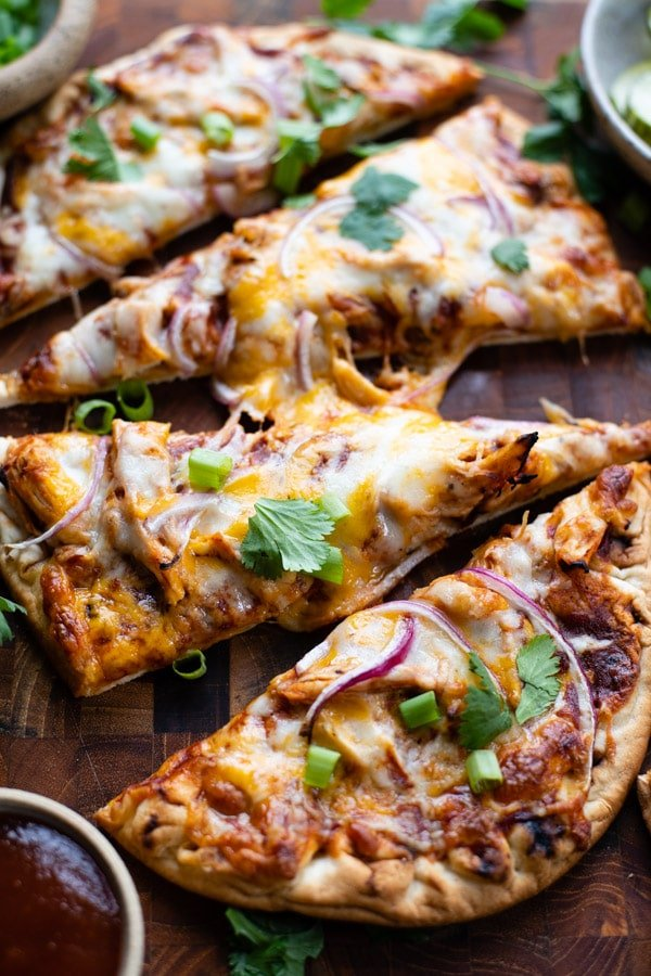 Close up overhead image of sliced bbq chicken flatbread pizza.