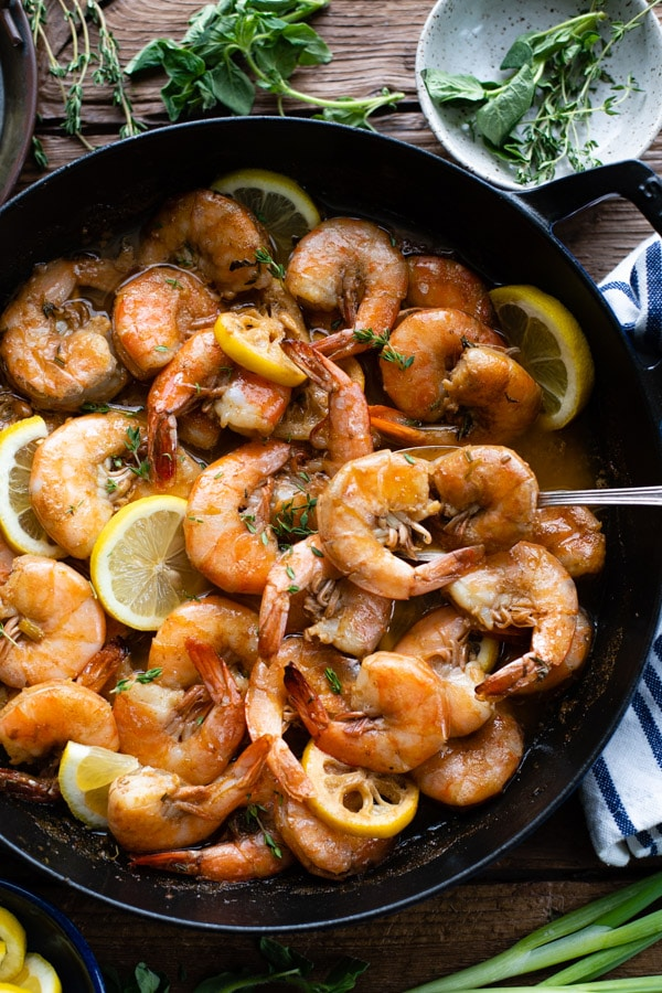 Overhead shot of New Orleans Style BBQ shrimp in a cast iron skillet