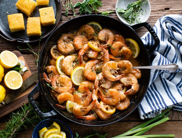 Horizontal overhead image of new orleans style bbq shrimp in a skillet