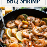 Side shot of BBQ Shrimp recipe in a pan with text title box at top