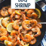 Overhead shot of BBQ Shrimp in a cast iron skillet with text title overlay