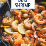 Side shot of a pan of Louisiana bbq shrimp with text title overlay