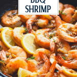 Close up side shot of New Orleans BBQ Shrimp with text title overlay
