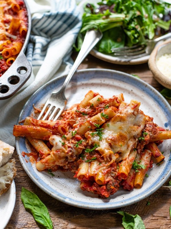 Fork on a plate of baked ziti with sausage