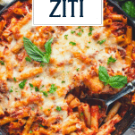 Pan of baked ziti with sausage with text title overlay