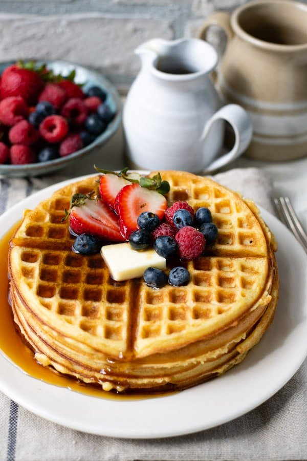 Syrup and butter on a plate of Bisquick waffles