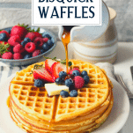 Pouring syrup on a plate of Bisquick waffles with text title overlay