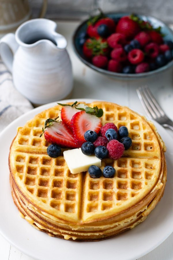 Shot of a plate of homemade waffles with fresh berries