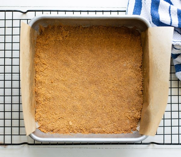 Graham cracker crust in an 8-inch square pan