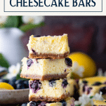 Stack of blueberry cheesecake bars with text title box at top