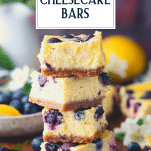 Close up stack of blueberry cheesecake bars with text title overlay