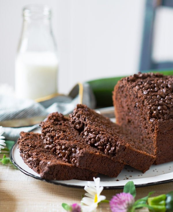 Side shot of a loaf of easy chocolate zucchini bread on a platter