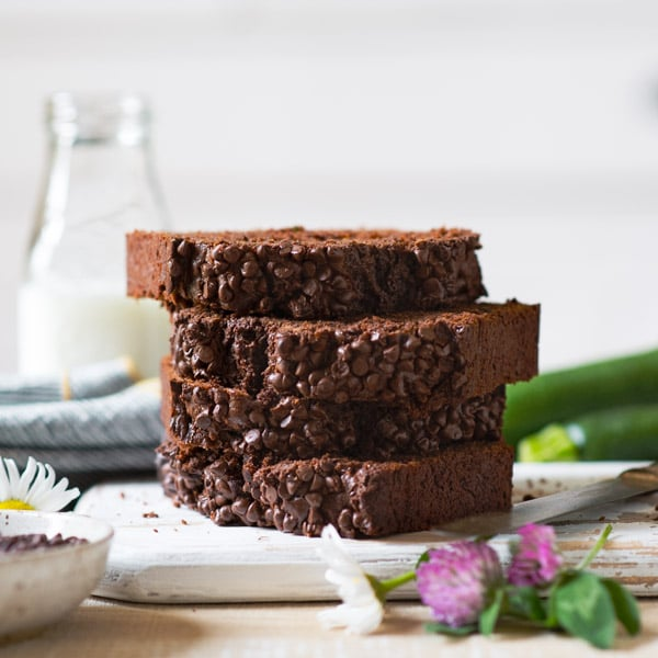 Square side shot of a stack of four slices of chocolate zucchini bread sour cream.