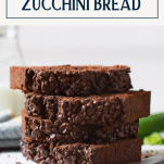 Stack of chocolate zucchini bread slices with text title box at top