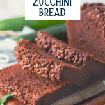 Sliced loaf of chocolate zucchini bread with text title overlay