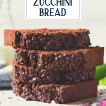 Stack of moist chocolate zucchini bread with text title overlay