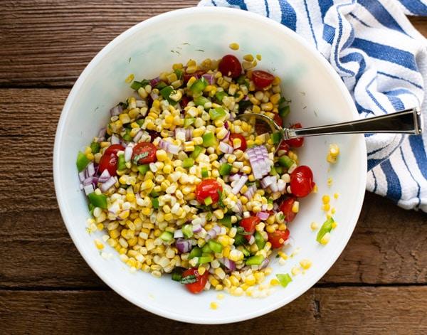 Process shot showing how to make summer corn salad