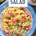 Overhead image of a bowl of fresh corn salad with text title overlay