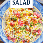 Close overhead shot of summer corn salad with text title overlay