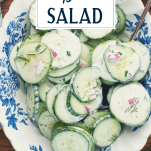 Close overhead shot of cucumber dill salad with text title overlay