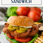 Fried chicken sandwich on a plate with text title box at top