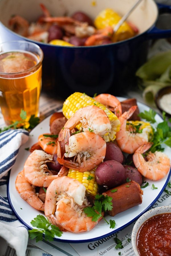 Lowcountry boil served on a platter over newspapers