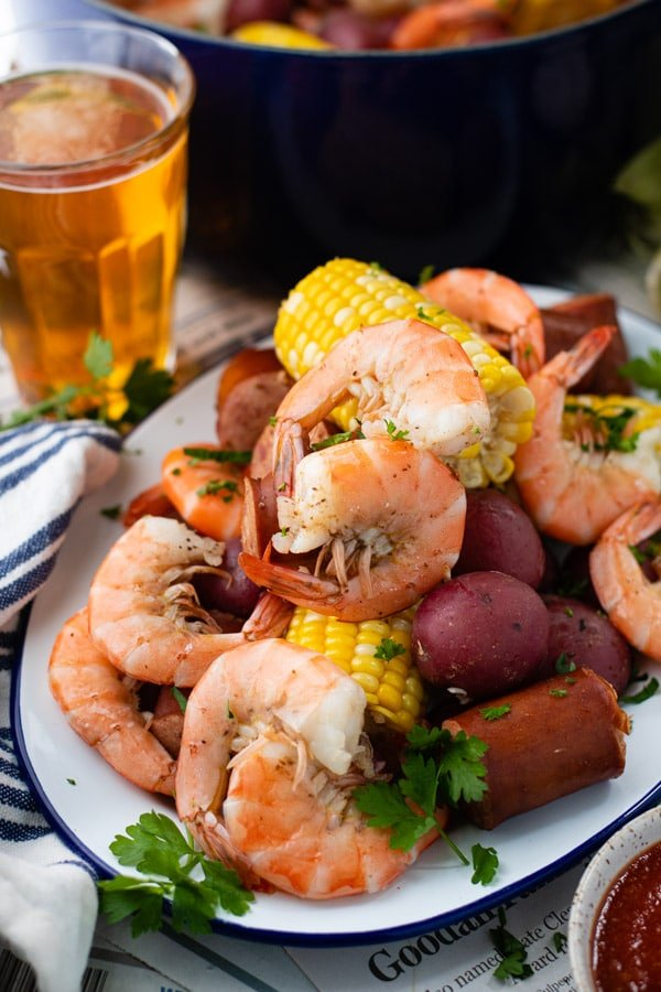 Side shot of a platter of authentic Frogmore Stew on a picnic table