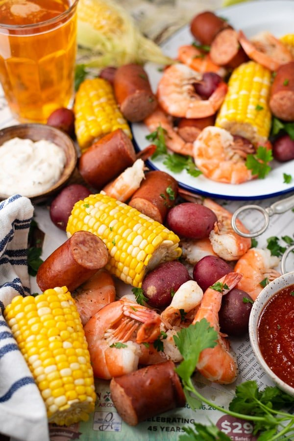 Frogmore stew spread on a picnic table with newspapers