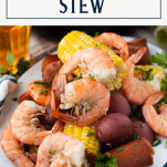 Side shot of a platter of Frogmore Stew with text title box at top