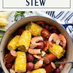 Overhead shot of a pot of Low Country Boil with text title box at top