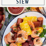 Overhead shot of a platter of Frogmore Stew with text title box at top