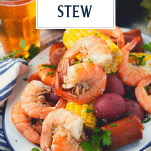 Side shot of Frogmore Stew on a platter with text title overlay