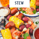 Frogmore stew on a picnic table with text title overlay