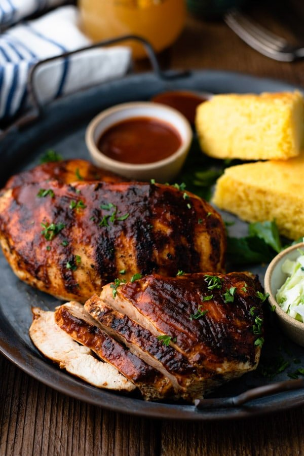Close up shot of grilled bbq chicken sliced on a platter
