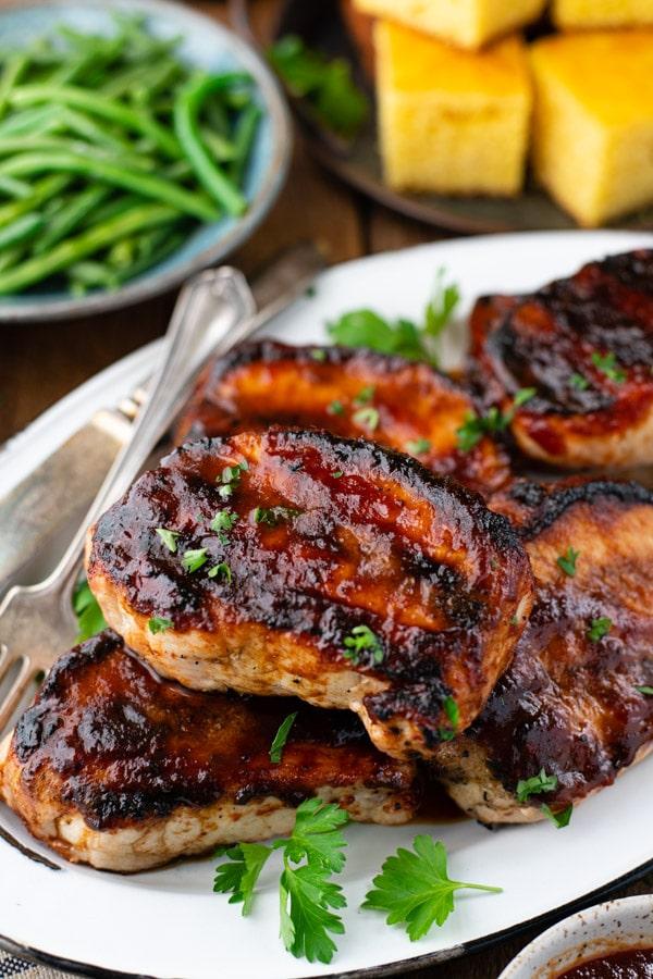 Close up shot of a platter of grilled bbq pork chops