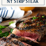 Grilled strip steak on a cutting board with text title box at top