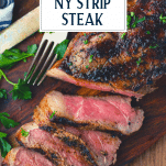 Overhead shot of grilled New York Strip on a cutting board with text title overlay at top