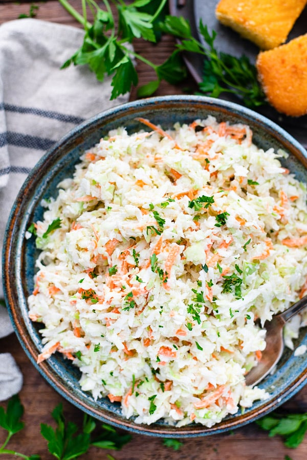 Close overhead image of homemade coleslaw in a serving bowl