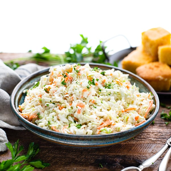 Square shot of easy homemade coleslaw in a bowl on a wooden table