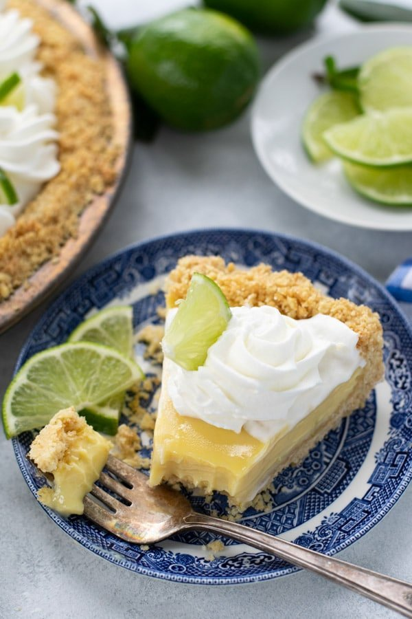 Slice of easy key lime pie recipe served on a blue and white plate