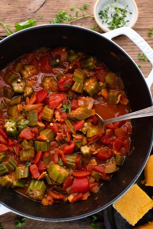 Close overhead shot of a pot of stewed okra and tomatoes