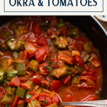 Spoon serving okra and tomatoes with text title box at top