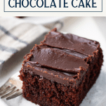 Slice of moist chocolate cake recipe with text title box at top