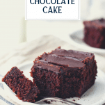 Front shot of a fork taking a bite of buttermilk chocolate cake with text title overlay