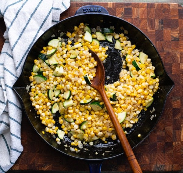Sauteeing corn and zucchini in a skillet