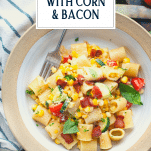 Bowl of creamy pasta with corn and text title overlay