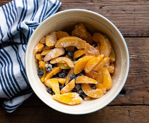 Peaches and blueberries in a bowl
